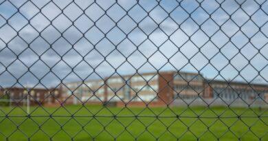 high-school-building-behind-a-fence